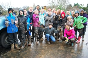 Muddy hands and muddy pants: the sign of a hard day's work!