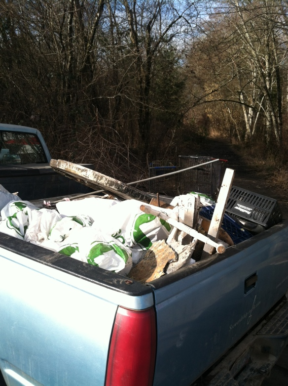 A truck full of trash and 3 shopping carts...not bad for a day's work!